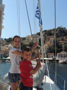 Hoisting the Greek flag in Symi.