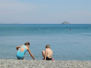 Kids playing - overlooked by warship.